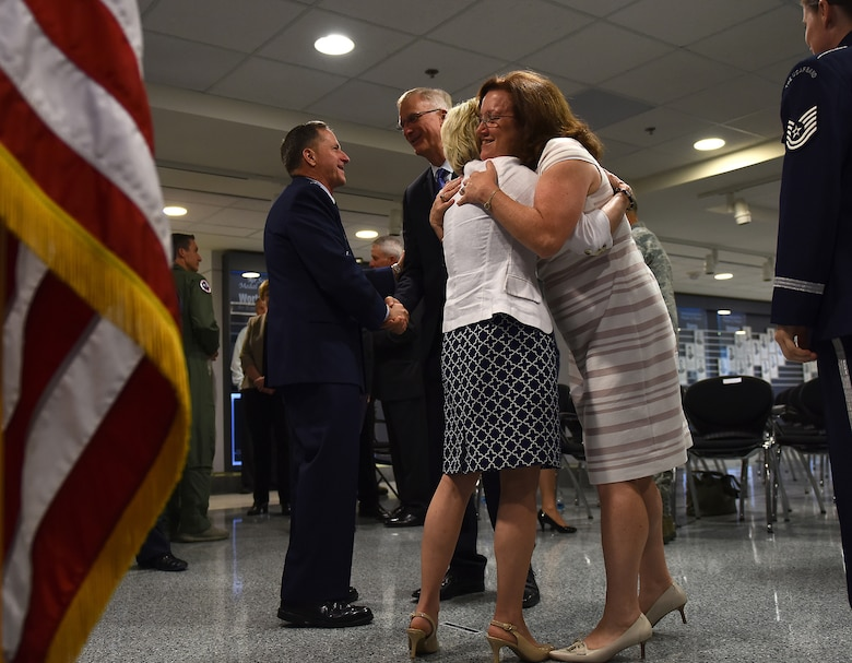 Air Force Chief of Staff Gen. David L. Goldfein and his wife, Dawn, shake hands and give hugs to well-wishers after Goldfein's swearing-in ceremony at the Pentagon in Washington, D.C., June 1, 2016. Goldfein became the 21st chief of staff of the Air Force. (U.S. Air Force photo/Tech Sgt. Dan DeCook)