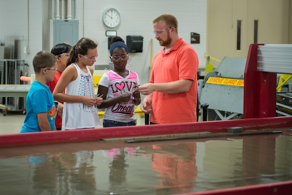 James McCanless, 336th Training Squadron machinist, demonstrates a water-jet cutting machine to Science, Technology, Engineering, and Mathematics Camp students June 23, 2016, on Keesler Air Force Base, Miss. Keesler partnered with the Biloxi School District, Biloxi, Miss. in a week-long summer program designed to educate and enrich middle school students interested in science, technology, engineering or mathematics. (U.S. Air Force photo by Marie Floyd/Released)