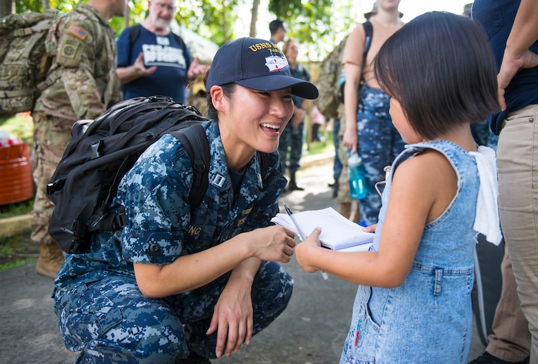 LIGAO CITY, Philippines (June 28, 2016) - Lt. Gabrielle Jung, a Navy dentist and native of Aurora, Colorado (left), talks with a student at Ligao West Central Elementary School during Pacific Partnership 2016. Jung was at the school as part of a cooperative health engagement where Pacific Partnership 2016 personnel attached to hospital ship USNS Mercy (T-AH 19) and members of the Armed Forces of the Philippines spent the day educating people on health care, hygiene and nutrition. Participants also provided direct care services including optometry, dental care and physical therapy. Pacific Partnership is visiting the Philippines for the seventh time since its first mission in 2006. Partner nations will work side-by-side with local military and non-government organizations to conduct cooperative health engagements, community relation events and subject matter expert exchanges to better prepare for a natural disaster or crisis.