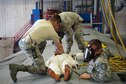 934th Maintenance Squadron members extract a simulated incapacitated person from a C-130 fuel cell.
