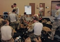 U.S. Airmen prepare equipment during the Military Freefall Jumpmaster Course at Davis-Monthan Air Force Base, Ariz., June 28, 2016. Students vary from tactical air control party specialists, combat controllers, pararescuemen, and survival, evasion, resistance and escape specialists from all different commands. (U.S. Air Force photo by Airman Nathan H. Barbour/Released)