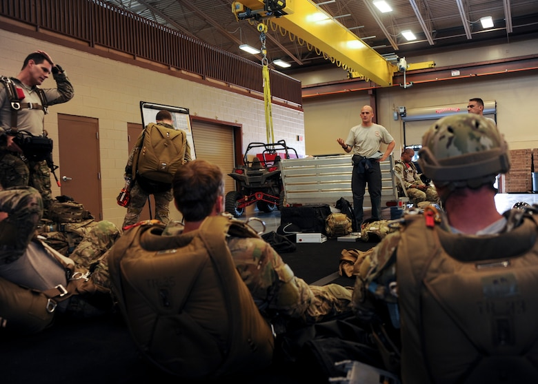 U.S. Airmen receive instructions during the Military Freefall Jumpmaster Course at Davis-Monthan Air Force Base, Ariz., June 28, 2016. The course will graduate 12 Airmen at the end of its fifth 3-week-long rotation; reaching a total number of 58 certified jumpmasters. (U.S. Air Force photo by Airman Nathan H. Barbour/Released)