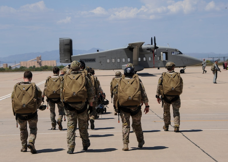 U.S. Airmen prepare to board a C-23 Sherpa during the Military Freefall Jumpmaster Course at Davis-Monthan Air Force Base, Ariz., June 28, 2016. During each free fall, the success of the mission and the lives of others are in the hands of the jumpmasters. (U.S. Air Force photo by Airman Nathan H. Barbour/Released)