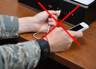 A photo illustration reminds Airmen not to plug unauthorized devices into government computers. (U.S. Air Force illustration/Tech. Sgt. James Brock)
