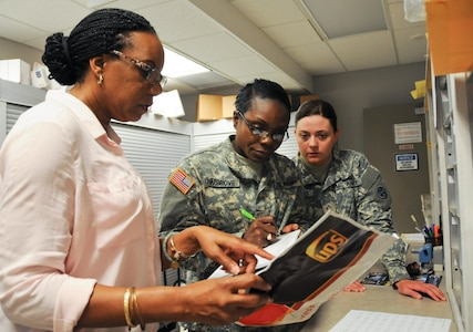 Angela Payne, official mail manager for the U.S. Army Reserve's 99th Regional Support Command (left), works with Soldiers from the U.S. Army Reserve's 678th Human Resources Company headquartered in Nashville, Tennessee, at 99th RSC headquarters on Joint Base McGuire-Dix-Lakehurst, New Jersey. This training kicked off 163 mailroom inspections conducted by the 678th over a two-week period at Army Reserve facilities throughout the northeastern United States as part of a pilot program hosted by the 99th RSC in order to provide real-world training opportunities to boost Soldier readiness.