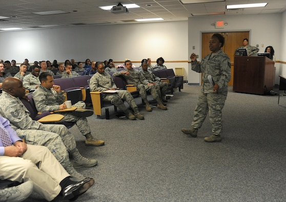Tech. Sgt. DeMonique Pettaway, 81st Training Wing Equal Opportunity Office NCO in charge, delivers a safety brief to Keesler personnel during an 81st TRW Stand Down Event at the Sablich Center June 29, 2016 on Keesler Air Force Base, Miss. Personnel received a safety brief on driving while under the influence of alcohol and learned ways to prevent DUIs in their units. (U.S. Air Force photo by Kemberly Groue/Released)