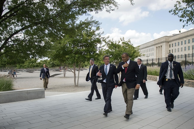 Defense Secretary Ash Carter speaks with Transportation Secretary Anthony Foxx as he gives him a tour of the Pentagon Memorial, July 1, 2016. DoD photo by Air Force Senior Master Sgt. Adrian Cadiz