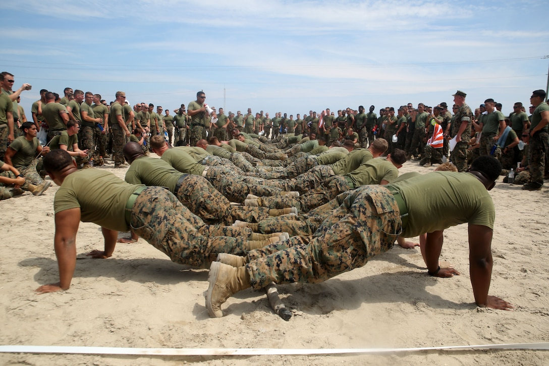 Marines assigned to the 10th Marine Regiment prepare to play tug-of-war as part of the Kings Games at Camp Lejeune, N.C., June 29, 2016. Marine Corps photo by Cpl. Joey Mendez