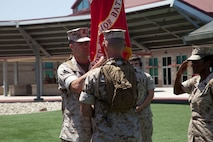 U.S. Marine Corps Lt. Col. Brian Dwyer, right, outgoing commanding officer, Wounded Warrior Battalion-West, relinquishes command to Lt. Col. Stephen Mount, left, commanding officer, WWBN-W, during a Change of Command Ceremony at Camp Pendleton, Calif., June 30, 2016.  A Change of Command is a military tradition that represents a formal transfer of authority and responsibility for a unit from one Commanding Officer to another. (U.S. Marine Corps photo by Lance Cpl. Brandon Martinez, MCIWEST-MCB CamPen Combat Camera/Released)