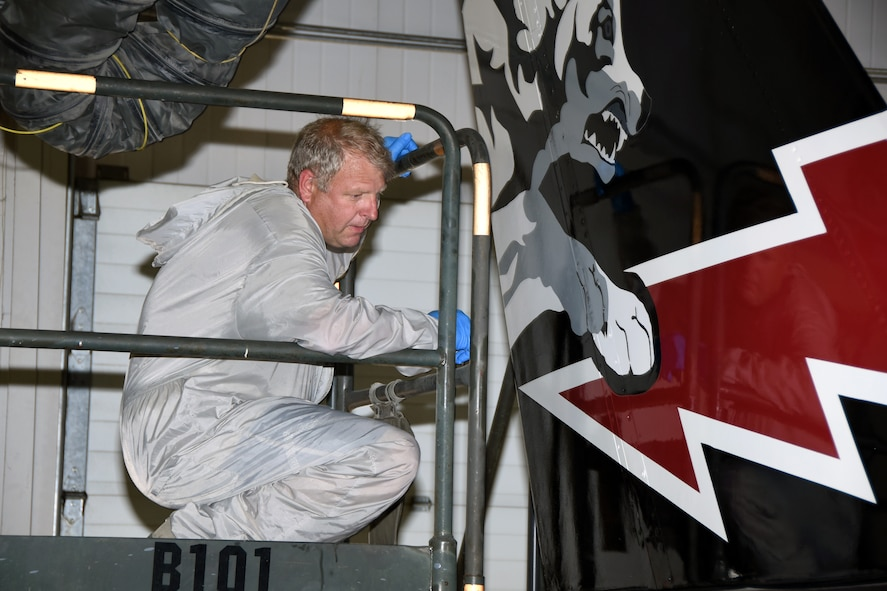 SIOUX FALLS, S.D.- Master Sgt. Roger Vearrier, 114th Maintenance Squadron fabrication technician, makes a final inspection of the 70th anniversary tail art that was painted on an F-16 assigned to the 114th Fighter Wing at Joe Foss Field in Sioux Falls, S.D, June 22, 2016. This year marks the 70th anniversary of the South Dakota Air National Guard and the unit will be flying this commemorative aircraft over the next few months to recognize this milestone. This aircraft, along with many more military and civilian aircrafts, will be on static display at the Sioux Falls Airshow at Joe Foss Field, July 23-24, 2016. (U.S. Air National Guard photo by Senior Master Sgt. Nancy Ausland/Released)