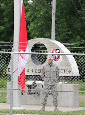Staff Sgt. Frank Alemar of the New York Air National Guard's 224th Support Squadron stands at parade rest during Canada Day ceremonies at the Eastern Air Defense Sector. A North American Aerospace Defense Command headquarters unit, EADS is composed of New York Air National Guardsmen and a Canadian Detachment, along with liaison officers from other U.S. military services and federal civilian employees.