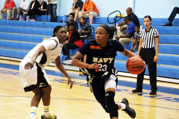 Navy Seaman Jameika Hoskins (#23) of USS Rushmore drives the lane in their opening game against Armyduring the 2016 Armed Forces Women's Basketball Championship at Joint Base San Antonio-Lackland AFB, Texas on 1 July.  Army wins 90-68