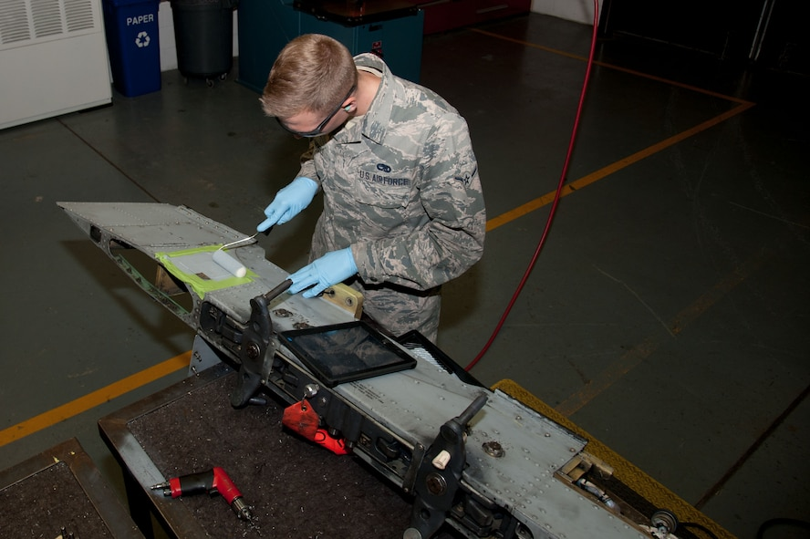 Airman Jared Chappell, 51st Maintenance Squadron aircraft structural maintenance, paints an A-10 Thunderbolt II pylon after repairing a crack at Osan Air Base, Republic of Korea, June 28, 2016. Chappell was repairing a crack in the pylon to return it to full mission capability. Chappell is assigned to structural maintenance shop and is part of the fabrication flight which also has non-destructive inspection and metals technology. Fabrication flight Airmen identify, repair and build parts to working order so that Osan airframes are ready to fight tonight.  (U.S. Air Force photo by Staff Sgt. Jonathan Steffen/Released)