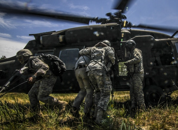 U.S. Army Reserve Soldiers from the 404th Civil Affairs Battalion transport simulated casualties to a New Jersey Army National Guard UH-60 Black Hawk helicopter during Exercise Gridiron at Joint Base McGuire-Dix-Lakehurst, N.J., June 27, 2016. (U.S. Air National Guard photo by Tech. Sgt. Matt Hecht/Released)