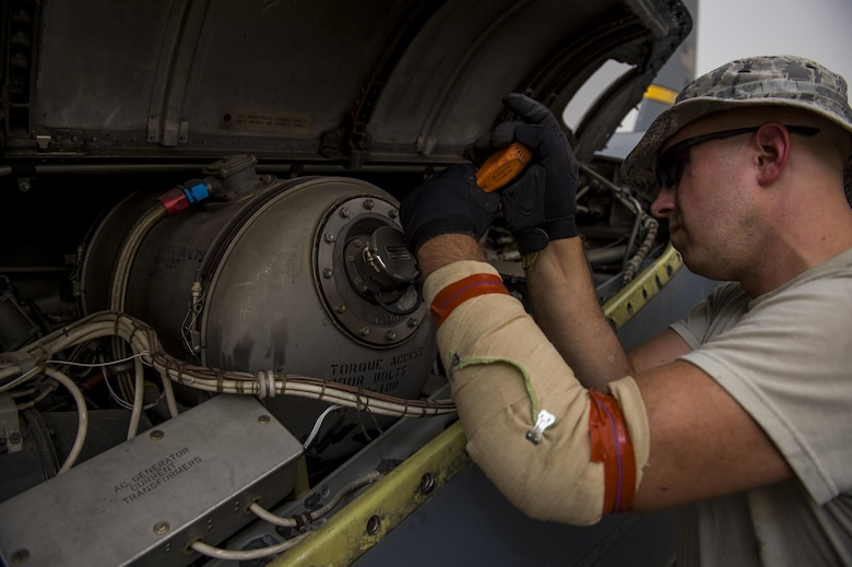 A U.S. Air Force maintainer from the Alaska Air National Guard's 144th Airlift Squadron works on a C-130 Hercules before it departs for a transport mission at an undisclosed location in Southwest Asia, June 16, 2016. The transport mission was one of the last combat missions during the 144th AS's final C-130 deployment. (U.S. Air Force photo by Staff Sgt. Douglas Ellis/Released)