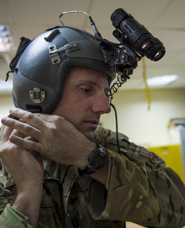 U.S. Air Force Capt. Jason Guinnee, 737th Expeditionary Airlift Squadron C-130 pilot from the Alaska Air National Guard's 144th Airlift Squadron, fastens his helmet before flying a transport mission at undisclosed location in Southwest Asia, June 17, 2016. The transport mission was one of the last combat missions during the 144th AS's final C-130 deployment. (U.S. Air Force photo by Staff Sgt. Douglas Ellis/Released)