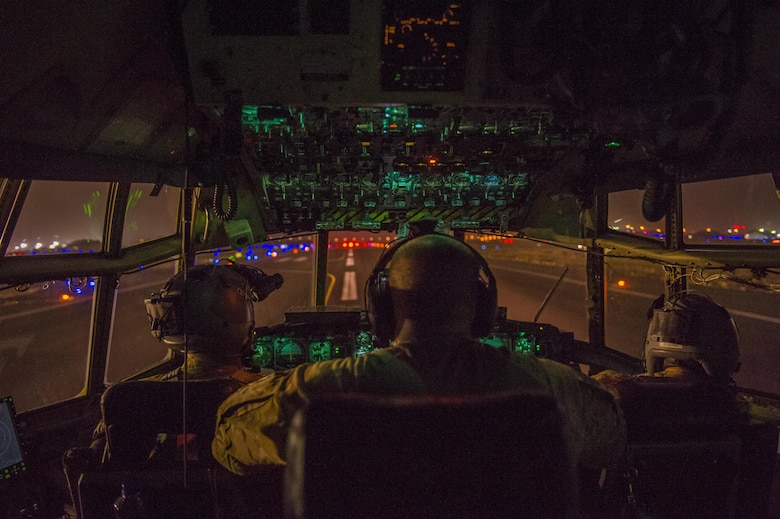 U.S. Air Force pilots from the Alaska Air National Guard's 144th Airlift Squadron prepare to take off in a C-130 Hercules at an undisclosed location in Southwest Asia, June 17, 2016. The transport mission was one of the last combat missions during the 144th AS's final C-130 deployment. (U.S. Air Force photo by Staff Sgt. Douglas Ellis/Released)