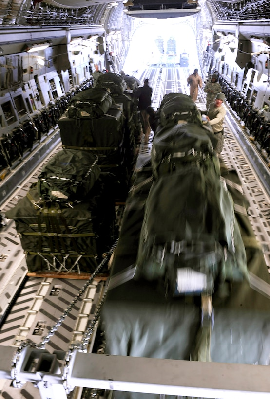 A C-17 Globemaster III aircrew from the 816th Expeditionary Airlift Squadron loads container delivery system bundles onto the aircraft prior to an airdrop mission Feb. 14 in Afghanistan.