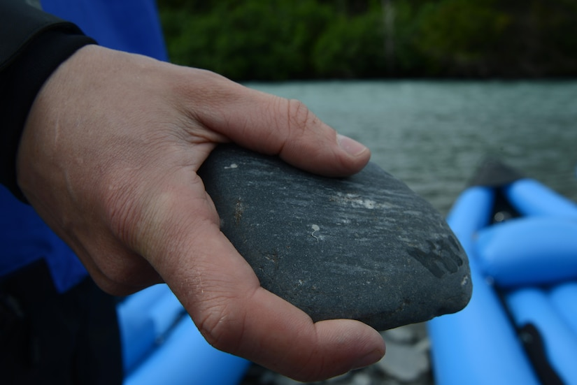 A kayaker skips stones at Portage River, Alaska, June 12, 2016. The kayaking trip took a few pauses along the way to rest, stretch, enjoy the view, and skip stones. Portage Lake was created by the glacial water of Portage Glacier and flows to Turnagain Arm. The OAP has introduced inflatable kayaking as the newest addition to the multiple trips available in the summer. (U.S. Air Force photo by Airman 1st Class Christopher R. Morales)