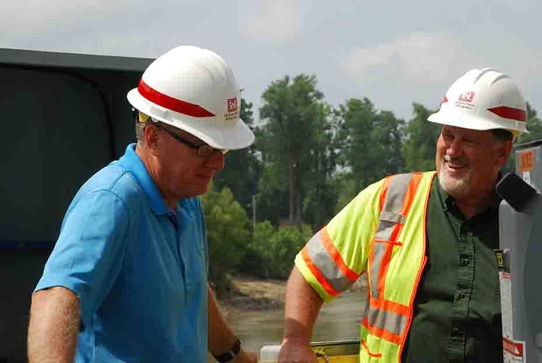 Left to right, Ed Dean and Dean Teeter discuss the progress of the Mhoon Landing site.