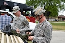 Sgt. Adam Burson, left, 416th Theater Engineer Command, and Master Sgt. Keith Clark, 85th Support Command prepare a Humvee to participate in Villa Park's annual Fourth of July parade, July 4, 2016.