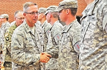 """Air Force Maj. Gen. Daryl Bohac, Nebraska National Guard adjutant general, shakes the hands of the Soldiers of the 1st Infantry Division's Main Command Post-Operational Detachment after the unit's activation ceremony June 26 at the Spirit of 1776 Armory in Lincoln, Nebraska. The new National Guard unit is attached to the """"Big Red One"""" with a mission to increase capacity and extend operations and support for the Main Command Post and the Division Headquarters and Headquarters Battalion."""