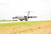 Pilots from the 3rd Airlift Squadron, 436th Airlift Wing at Dover Air Force Base land a C-17 Globemaster III June 25 at Savage Airfield on Fort Riley. This was the first time a C-17 landed at Savage Field.