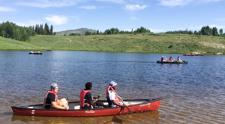 Members of the Youth Leadership Camp, sponsored by Air Force Services Agency Child and Youth Programs and hosted by Buckley Air Force Base, canoe June 27 – July 1 at the Snow Mountain Ranch in Granby, Colo. Youth from around the world came together to learn leadership techniques and build confidence for their future years of high school and beyond. (U.S. Air Force photo by Tech. Sgt. Nicholas Rau)