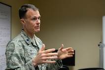 Lt. Col. Zachary Owen, 3rd Space Experimentation Squadron commander, addresses his team and distinguished guests during a satellite control authority transfer ceremony for the Automated Navigation and Guidance Experiment in Local Space satellite at Schriever Air Force Base, Colorado, Tuesday, July 5, 2016. The transfer of satellite control authority from Air Force Research Laboratory gives the 50th Space Wing a new level of authority over the satellite to dictate tasks and commands directly to the equipment. (U.S. Air Force photo/Christopher DeWitt)