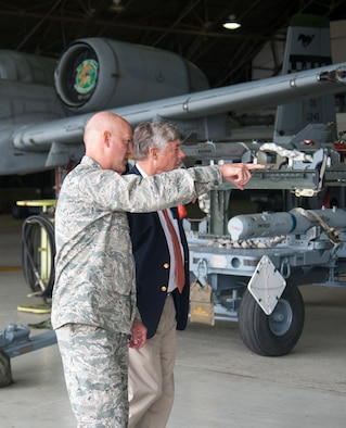 Col. Andrew Hansen, 51st Fighter Wing commander, gives an overview of Osan's aircraft to U.S. Rep. Fred Upton at Osan Air Base, Republic of Korea, June 30, 2016. Upton and other congressmen visited Osan to better understand the U.S. military presence on the Korean Peninsula. In addition to seeing Osan's aircraft, the congressmen had lunch with Airmen from their respective states. Reps. Morgan Griffith, Pete Olson, Greg Walden, John Shimkus, Edward Whitfield and Fred Upton were in attendance. (U.S. Air Force photo by Staff Sgt. Jonathan Steffen/Released)