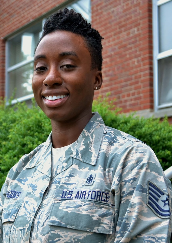 Tech. Sgt. Elisha Rhodes, a recruiter with the 111th Attack Wing's Strength Management Team, stands for photo at Horsham Air Guard Station, Pa., July 5, 2016. Rhodes is one the newest recruiters on the SMT here and has a background in the medical field from her time in the active-duty Air Force. (U.S. Air National Guard photo by Tech. Sgt. Andria Allmond)
