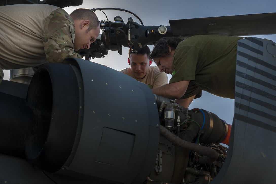 U.S. Air Force Tech. Sgt. Matthew Chambers, Tech. Sgt. Jesus Garcia, and Jon Miller, 33rd Rescue Squadron special mission aviators, perform a pre-flight check June 20, 2016, at Kadena Air Base, Japan. As the 33rd RQS was commencing their check, the aviators monitored the different parts of the HH-60G Pave Hawk for any discrepancies. (U.S. Air Force photo by Airman 1st Class Lynette M. Rolen)