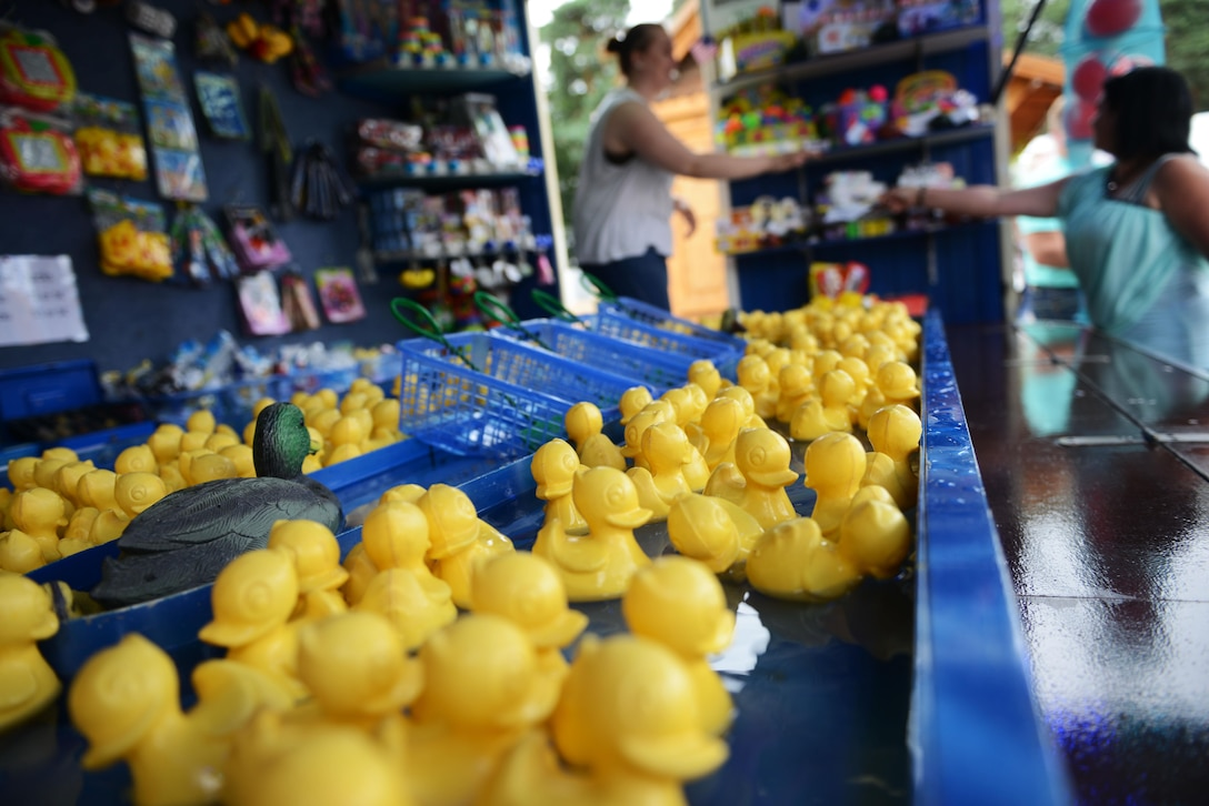 Rubber ducks float in the water at a kiosk during the Freedom Fest 2016 at Ramstein Air Base, Germany, July 4, 2016. The Independence Day celebration included a variety of foods, games, rides and fireworks for Kaiserslautern Military Community members. (U.S. Air Force Photo/ Airman 1st Class Joshua Magbanua)