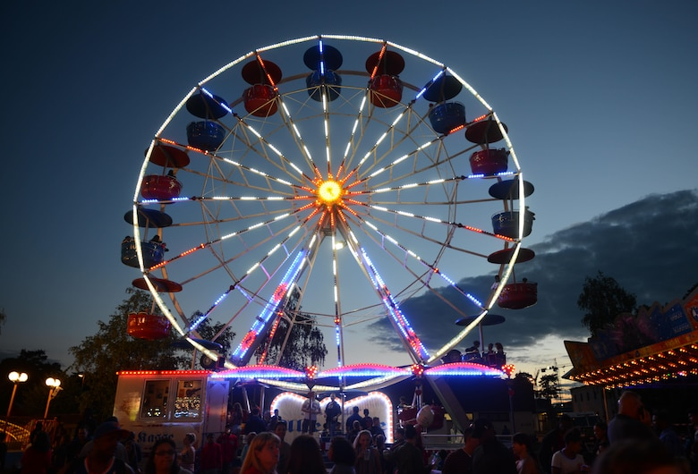 Carnival goers attend the Freedom Fest 2016 festivities at Ramstein Air Base, Germany, July 4, 2016. The Independence Day celebration included a variety of foods, games, rides and fireworks for Kaiserslautern Military Community members. The festival culminated with a fireworks display in the evening. (U.S. Air Force photo/ Airman 1st Class Joshua Magbanua)
