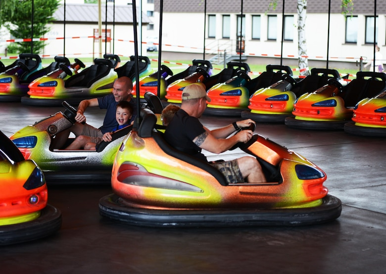 Festival goers enjoy a bumper car ride during Freedom Fest 2016 at Ramstein Air Base, Germany, July 4, 2016. The Independence Day celebration included a variety of foods, games, rides and fireworks for Kaiserslautern Military Community members. The event was sponsored by the 86th Force Support Squadron. (U.S. Air Force Photo/ Airman 1st Class Joshua Magbanua)