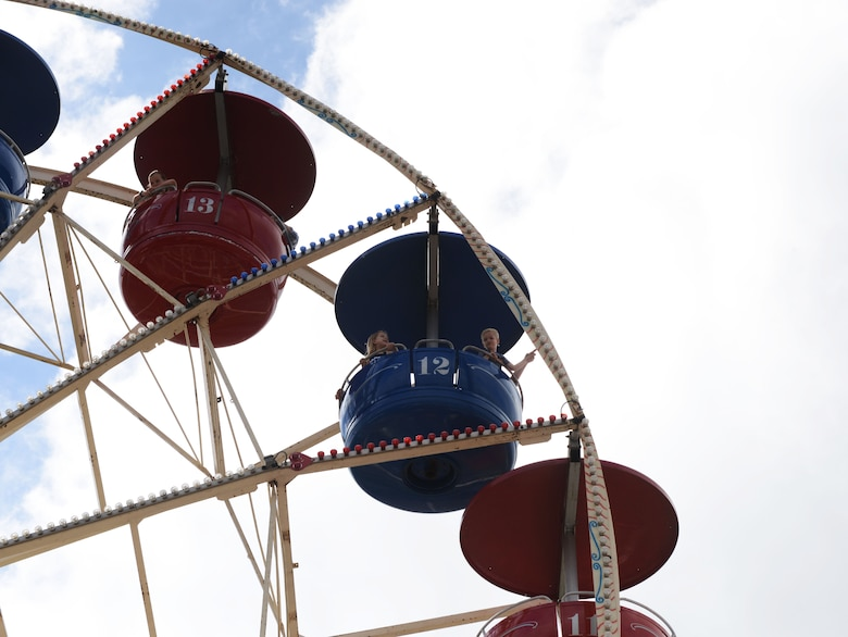 Children ride a Ferris wheel during Freedom Fest 2016 at Ramstein Air Base, Germany, July 4, 2016. The Independence Day celebration included a variety of foods, games, rides and fireworks for Kaiserslautern Military Community members. (U.S. Air Force Photo/ Airman 1st Class Joshua Magbanua)