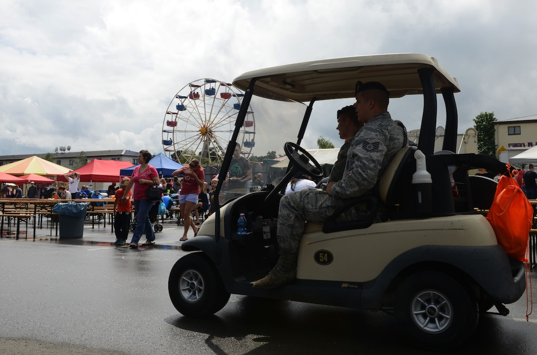86th Security Forces Squadron members conduct a patrol during Freedom Fest 2016 at Ramstein Air Base, Germany, July 4, 2016. The Independence Day celebration included a variety of foods, games, rides and fireworks for Kaiserslautern Military Community members. (U.S. Air Force Photo/ Airman 1st Class Joshua Magbanua)