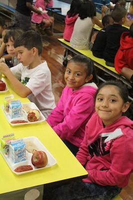 Students at Eugene Field Elementary School in Oklahoma enjoy a nutritious meal during their five-week summer school program. DLA Troop Support's Subsistence supply chain provides produce to schools in 48 states in partnership with the U.S Department of Agriculture.