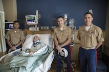 Lance Cpl. Luis Acosta, a maintenance management specialist with Combat Logistics Battalion 453, Richard Mathis, a Marine veteran, Capt. Joshua Miller, operations officer for Recruiting Station Denver, and Staff Sgt. Scott Rosenbach, a recruiter with RS Denver, pose for a photo at the St. Anthony Hospital & Medical Campus in Lakewood, CO June 29, 2016. Mathis suffered a broken neck from a fall that occurred approximately three weeks prior to the visit.