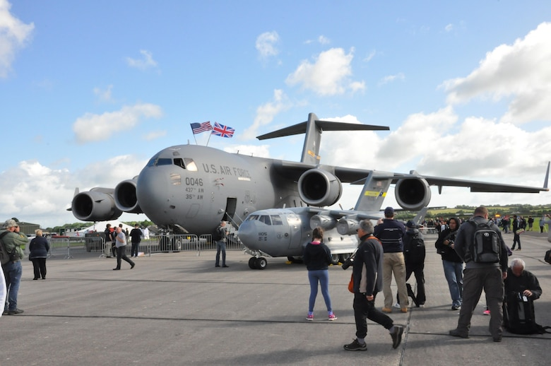 A Charleston C-17 Globemaster III and the 315th Airlift Wing's mini C-17 were popular attractions at the Yeovilton Air Day 2016 at Royal Naval Air Station Yeovilton, England July 2. Nearly 40,000 people crowded into the small British Navy base in order to get peek at aircraft from all over the world. Reservists from the 315th Airlift Wing, participated in the annual air show while also bringing home the show's top prize, the best static display award. (U.S. Air Force photo by Maj. Wayne Capps)