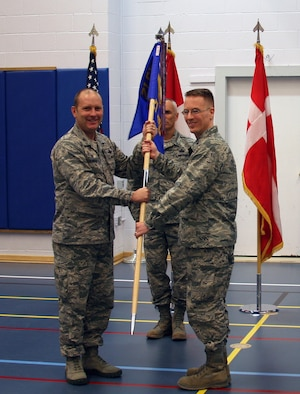THULE AIR BASE, Greenland – Col. Doug Schiess, 21st Space Wing commander, presents the guidon to Col. Christopher Eagan, 821st Air Base Group commander, during a change of command ceremony at Thule Air Base, Greenland on June 28, 2016. As the 821st ABG commander, Eagan is responsible for the administration and security of the Thule Defense Area, the Air Force's largest overseas and the United States' northernmost military installation. (U.S. Air Force photo by Master Sgt. Stoney Bair)
