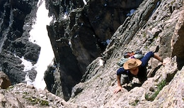 Seeking a view of Colorado from up high, Matt Montgomery is seen here climbing Longs Peak, elevation 14, 259 feet. Longs Peak is located in Rocky Mountain National Park, outside Estes Park, Colorado.