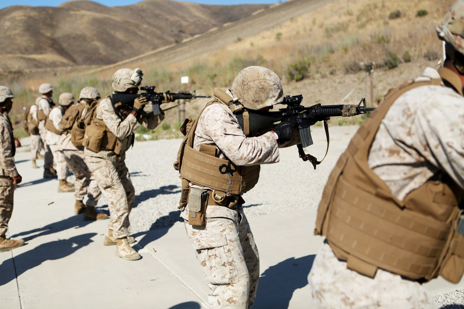 U.S. Marines with Combat Logistics Battalion 1, 1st Marine Logistics Group, fire their weapons in the table three course of fire during the Combat Leader's Course aboard Camp Pendleton Calif., from June 13-24, 2016. Combat Leader's Course is an advanced combat skills course instructed by the Combat Skills Training School, designed to teach Marines tactical leadership principles, machine gun functions, combat orders and various other skills. (U.S. Marine Corps photo by Sgt. Carson Gramley/released)