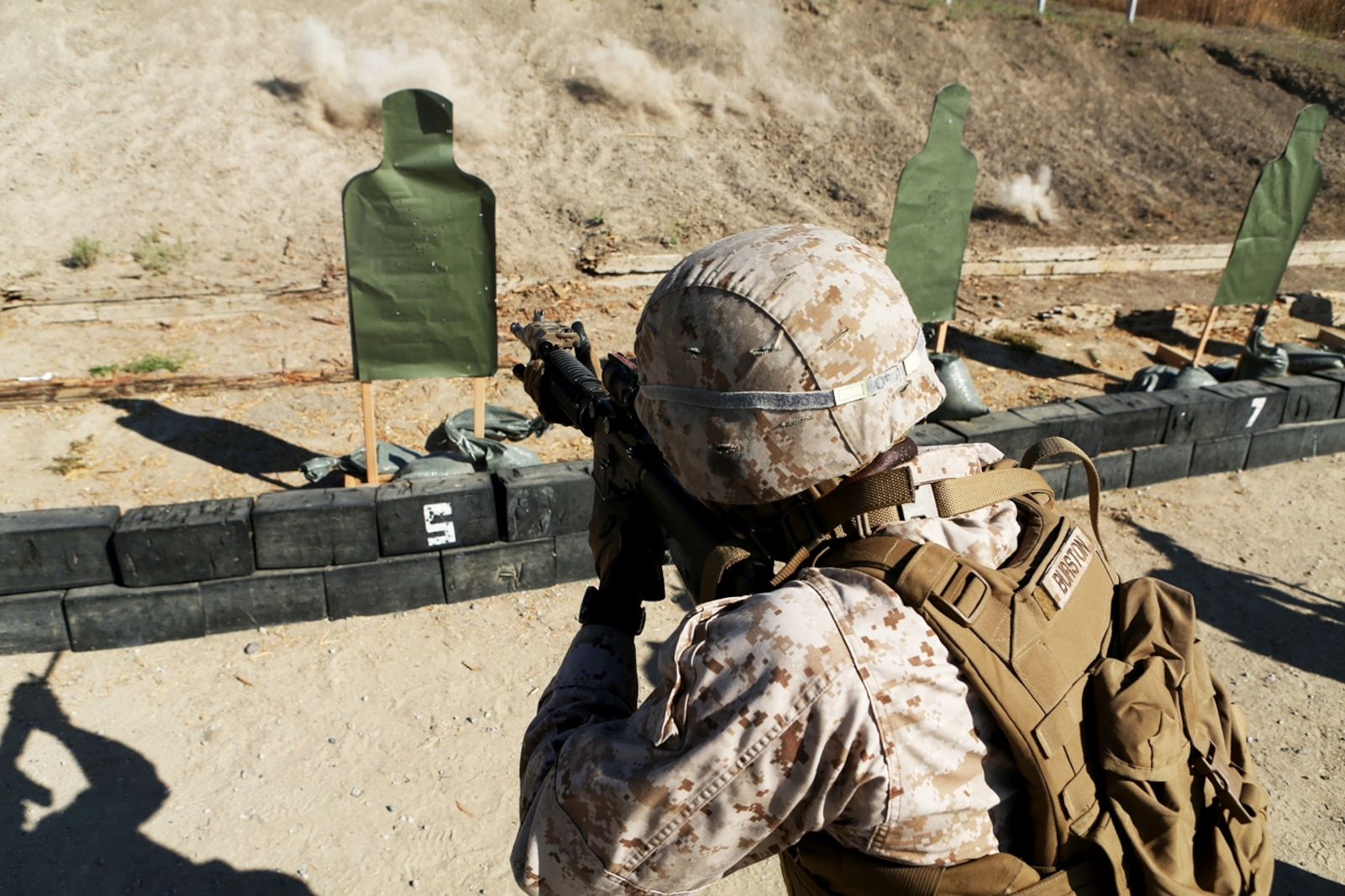 U.S. Marine Cpl. Nigel Burston engages his target in the table three course of fire during the Combat Leader's Course aboard Camp Pendleton Calif., from June 13-24, 2016. Burston is a combat engineer with Headquarters and Support Company, Combat Logistics Battalion 1, 1st MLG. Combat Leader's Course is an advanced combat skills course instructed by the Combat Skills Training School, designed to teach Marines tactical leadership principles, machine gun functions, combat orders and various other skills. (U.S. Marine Corps photo by Sgt. Carson Gramley/released)