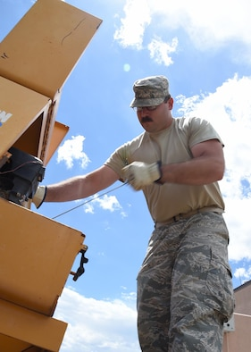 Staff Sgt. John Dodd, 50th Civil Engineering Squadron heavy equipment operator, starts up a cement mixer at Schriever Air Force Base, Colorado, Tuesday, July 5, 2016. Dodd and other CES Airmen were preparing to fulfill one of the 1,000+ work orders that the 50 CES can receive in a month. (U.S. Air Force Photo/Staff Sgt. Matthew Coleman-Foster)