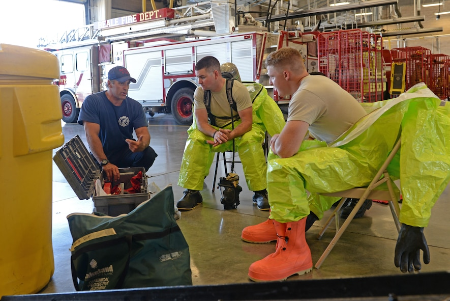 Brian Atkins (left), 9th Civil Engineer Squadron (CES) fire captain, educates Senior Airman Bradley Willock (middle), 940th CES firefighter, and Airman Joseph Brandt, 9th CES firefighter, on hazardous material containment tools June 30, 2016, at Beale Air Force Base, California. Beale's Fire Departments conduct daily proficiency training to remain ready to respond for an incident. (U.S. Air Force photo by Senior Airman Ramon A. Adelan)
