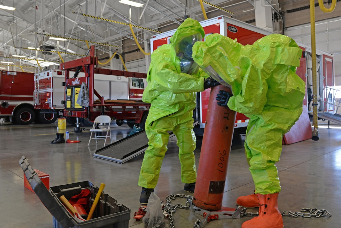 Senior Airman Bradley Willock (left), 940th Civil Engineer Squadron (CES) firefighter, and Airman Joseph Brandt, 9th CES firefighter, conduct hazardous material containment training June 30, 2016, at Beale Air Force Base, California. Beale's Fire Departments conduct daily proficiency training to remain ready to respond for an incident. (U.S. Air Force photo by Senior Airman Ramon A. Adelan)