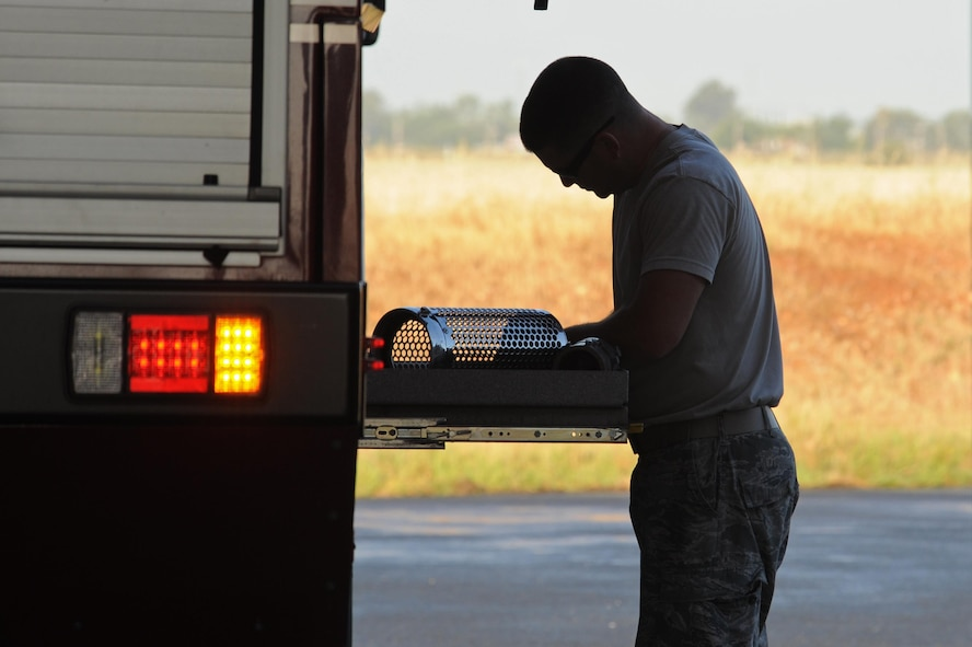 Senior Airman Bradley Willock, 940th Civil Engineer Squadron (CES) fire fighter, conducts a daily check of vehicles and equipment June 30, 2016, at Beale Air force Base, California. The Beale Fire Department's responsibility is to protect base personnel, property and the environment from fire and disaster on the installations approximately 23,000 acres. (U.S. Air Force photo by Senior Airman Ramon A. Adelan)