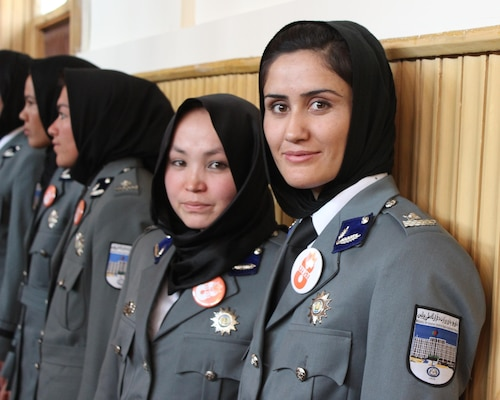 The women pictured were among 389 graduates of the Afghan National Police (ANP) Basic Police Officer Training waiting to be recognized in Kabul, Afghanistan, March 13, 2016. Memphis District engineers are participating in a Reachback Engineering project that supports increasing the ANP's capacity to house and train more female officers to combat insurgency. An increase in the number of trained female officers enhances the ANP's effectiveness because female officers can enter certain places and form bonds with other females in the community that their male counterparts cannot due to cultural propriety. (U.S. military photo by Lt. Charity Edgar/Released)