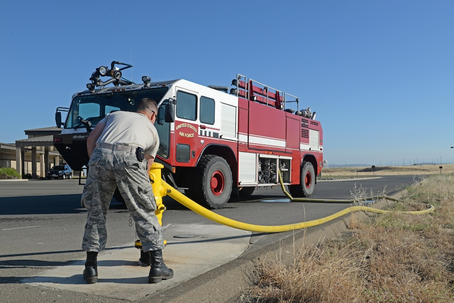 Senior Airman Bradley Willock, 940th Civil Engineer Squadron (CES) fire fighter, fills a fire engine with water June 30, 2016, at Beale Air force Base, California. The Beale Fire Department's responsibility is to protect base personnel, property and the environment from fire and disaster on the installations approximately 23,000 acres. (U.S. Air Force photo by Senior Airman Ramon A. Adelan)